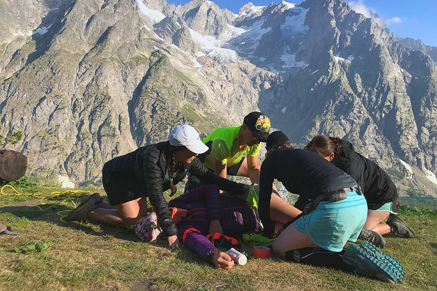 Wilderness medicine class trying to ignore the scenery and focus on the patient. Refugio Bonatti, Val Ferret, Italy